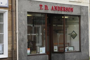 T.D. ANDERSON